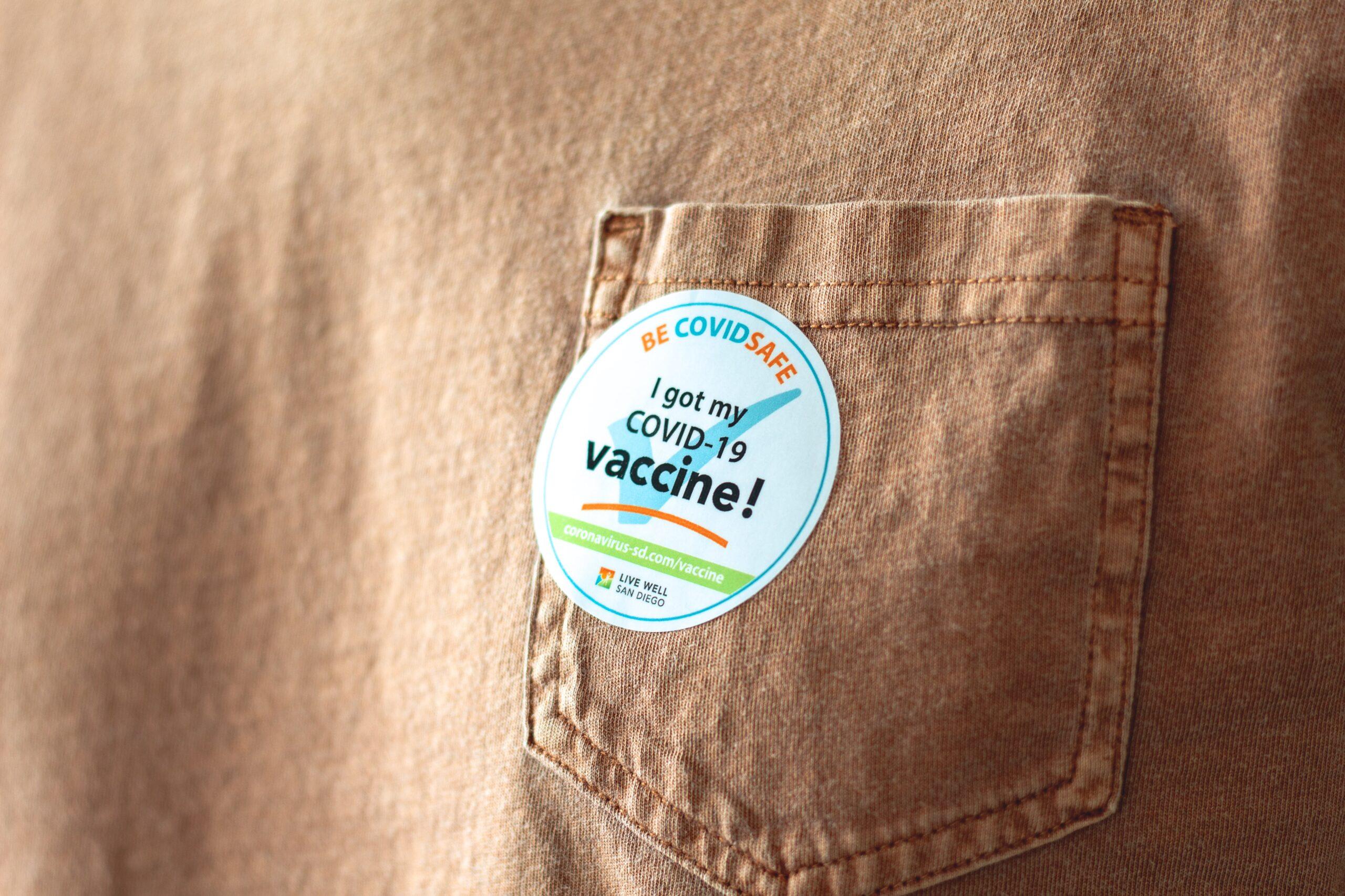 Person with a COVID-19 vaccination sticker
