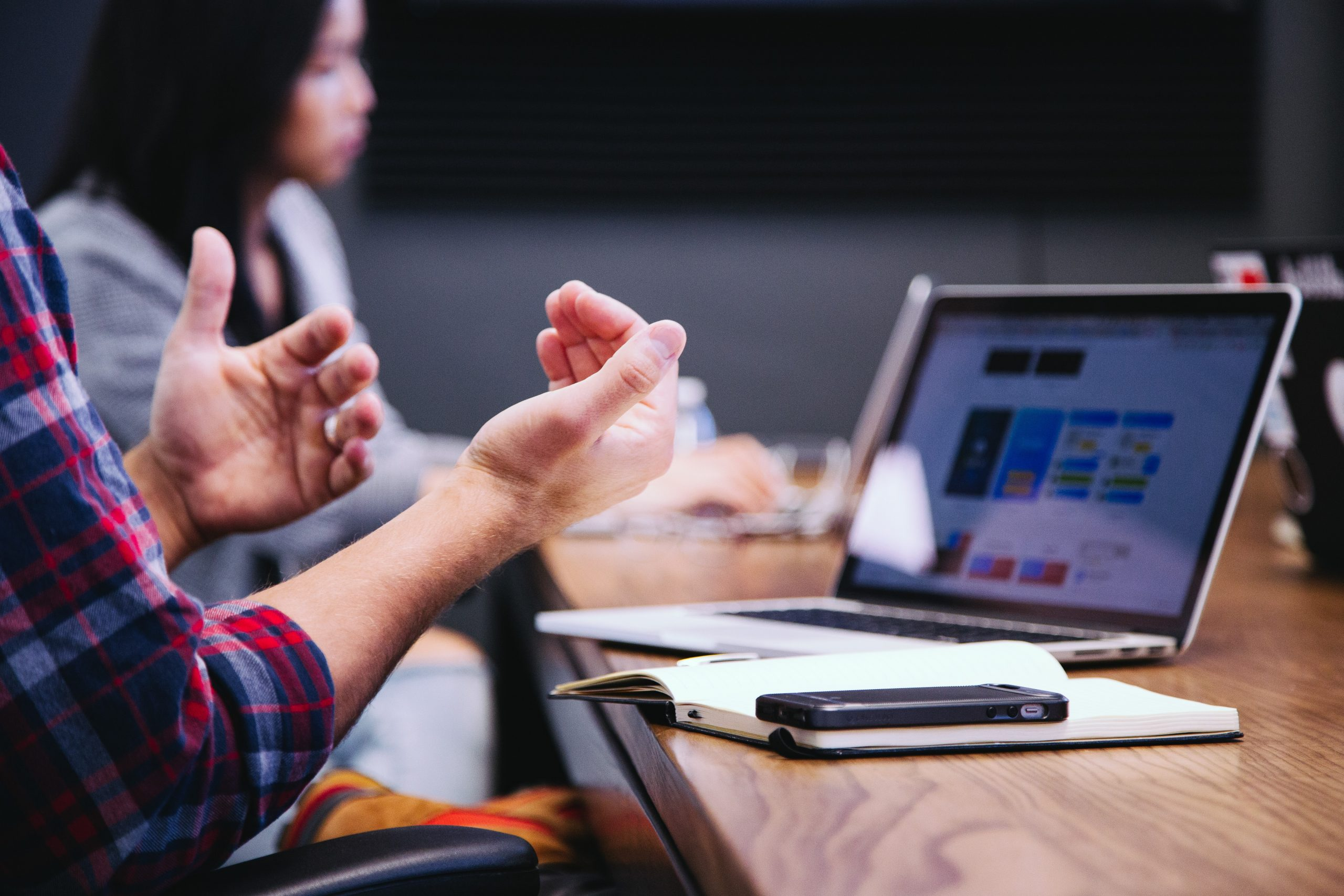 exasperated hands in front of a laptop after ignoring interview red flags